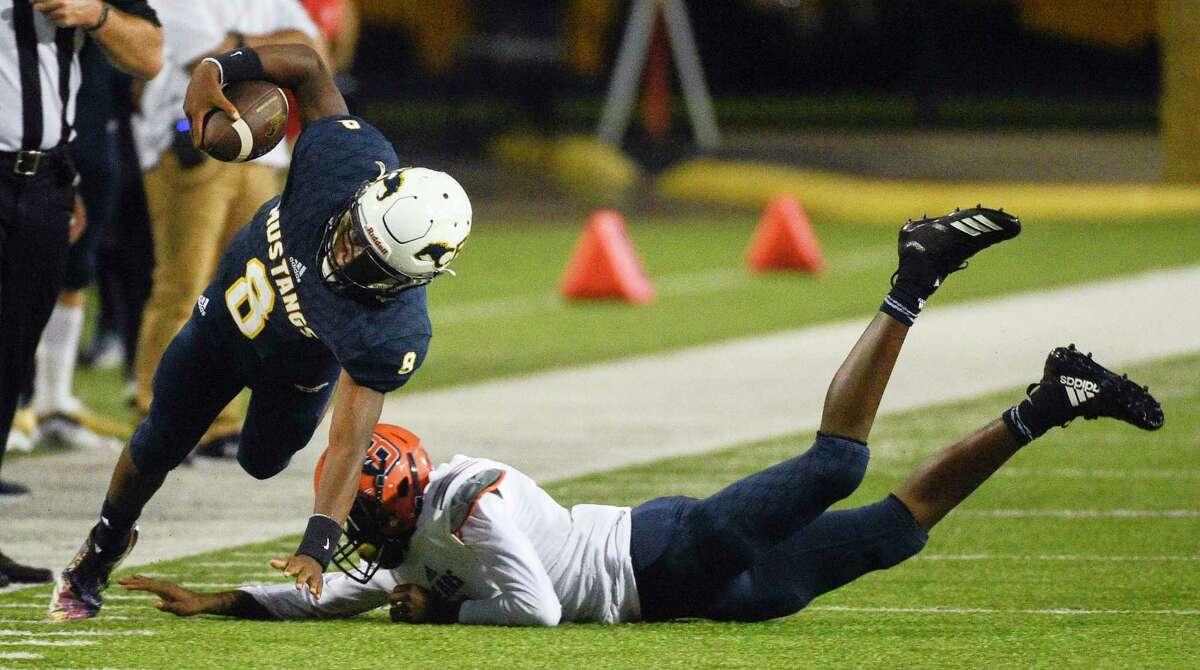 Cy-Ranch quarterback DJ Ciers, left, is tripped up by Bridgeland defensive back Bryce McMorris during the first half of a high school football game, Friday, Sept. 21, 2018, in Cypress, TX.