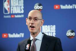 FILE - In this May 31, 2018, file photo, NBA Commissioner Adam Silver speaks at a news conference before Game 1 of basketball's NBA Finals between the Golden State Warriors and the Cleveland Cavaliers in Oakland, Calif. Silver wants all teams to hire more women, especially in leadership and supervisory positions, and is urging them to take some of the mandates that the Dallas Mavericks must now adhere to as an impetus to improve working conditions within their own organizations, according to a memo sent to all teams Friday, Sept. 21, 2018, and obtained by The Associated Press (AP Photo/Jeff Chiu)