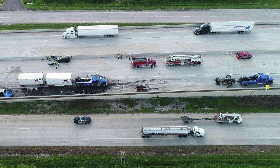 Five people died from two separate accidents on Interstate 10 early Thursday morning.  Pictured, a drone image shows the first accident near Major Drive where three people died at the scene and another person hours later. The second wreck occurred near the Goodyear facility where a Deepark man was also killed.