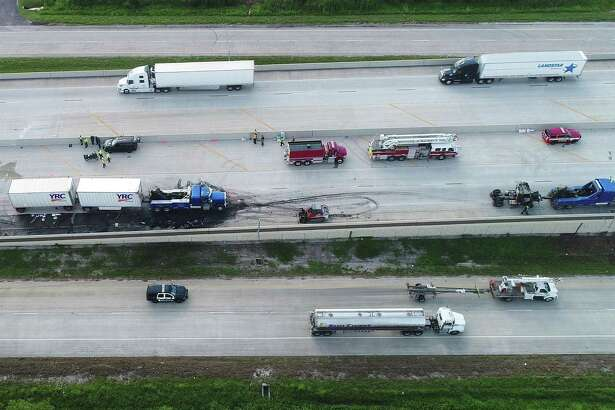Five people died from two separate accidents on Interstate 10 early Thursday morning. Pictured, a drone image shows the first accident near Major Drive where three people died at the scene and another person hours later. The second wreck occurred near the Goodyear facility where a Deepark man was also killed. Photo taken Thursday, 9/20/18