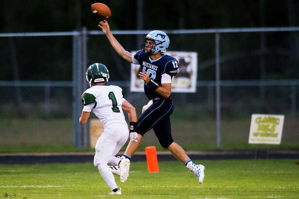 Meridian senior Brett Barriger makes a pass during a game against Clare on Friday, Sept. 21, 2018 at Meridian Early College High School. (Katy Kildee/kkildee@mdn.net)