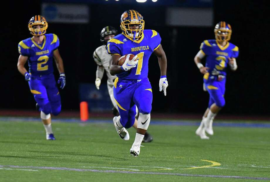 Nicholas Henderson (1) of the Brookfield Bobcats finds running room during a game against the Joel Barlow Falcons on Friday Sept. 21, 2018, at Brookfield High School in Brookfield, Connecticut. Photo: Gregory Vasil / For Hearst Connecticut Media / Connecticut Post Freelance