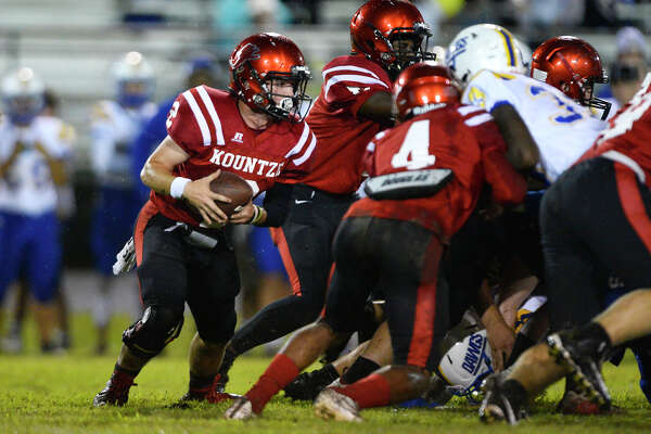 Kountze quarterback Brayden Voigtman carries against Kelly at Lion Stadium on Friday night. Photo taken Friday 9/21/18 Ryan Pelham/The Enterprise