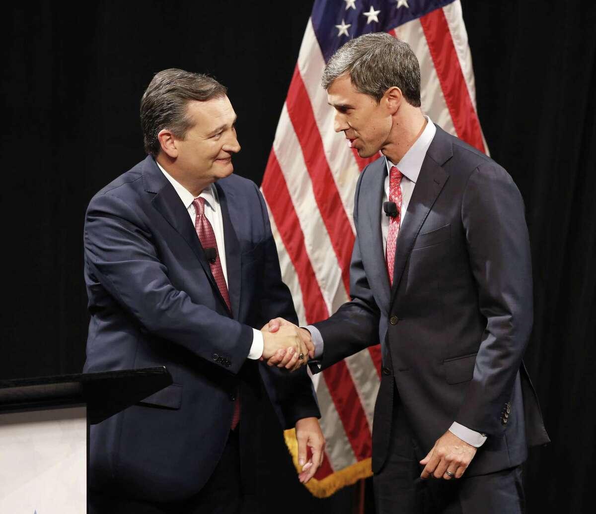 Republican U.S. Senator Ted Cruz, left, and Democratic U.S. Representative Beto O'Rourke, right, shake hands before their first debate for the Texas U.S. Senate in Dallas, Friday Sept. 21, 2018. (Nathan Hunsinger/The Dallas Morning News via AP, Pool)