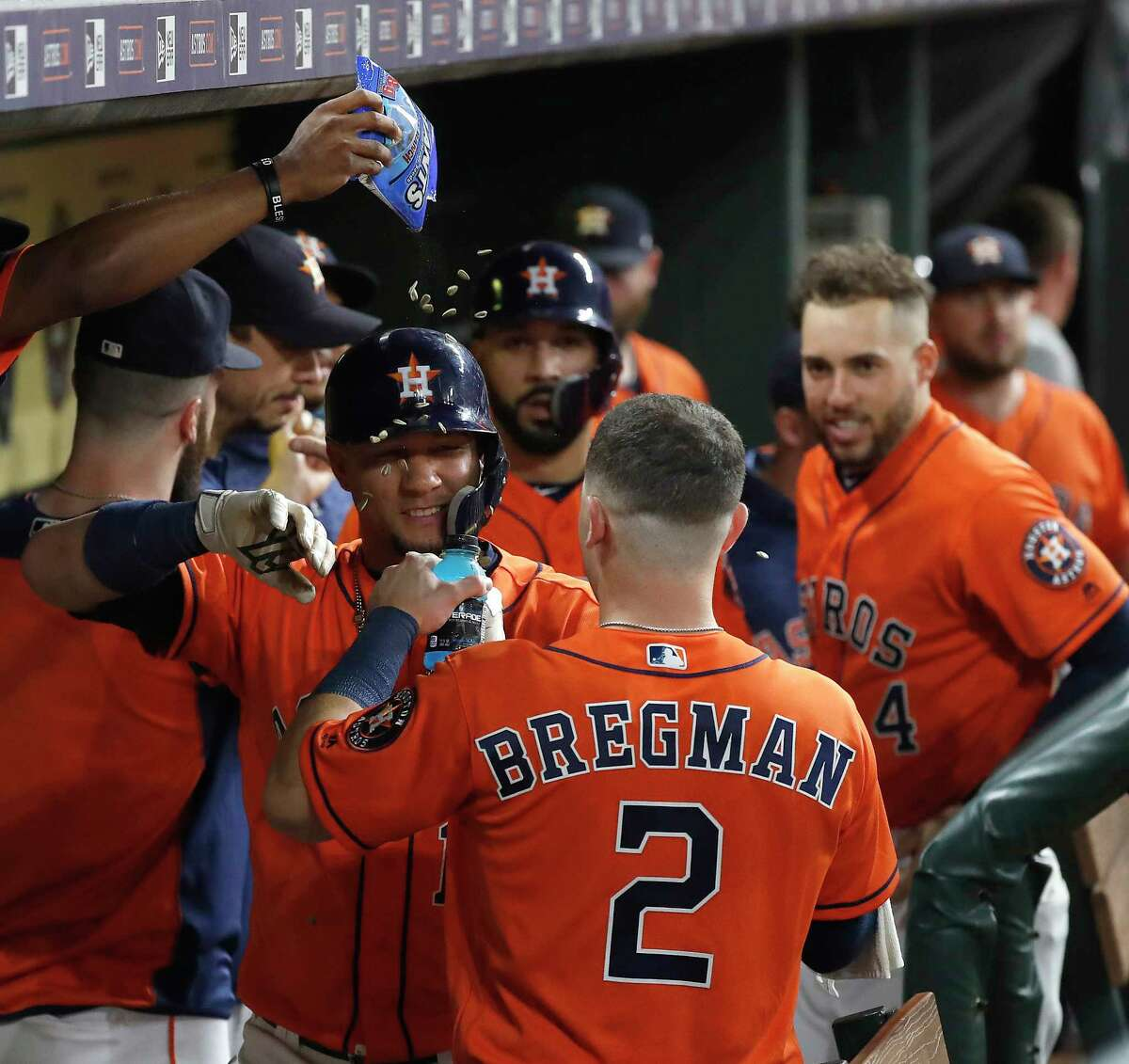 Houston Astros Yuli Gurriel (10) gets a sunflower seed shower after his second home run of the night during the third inning of an MLB baseball game at Minute Maid Park, Friday, September 21, 2018, in Houston.