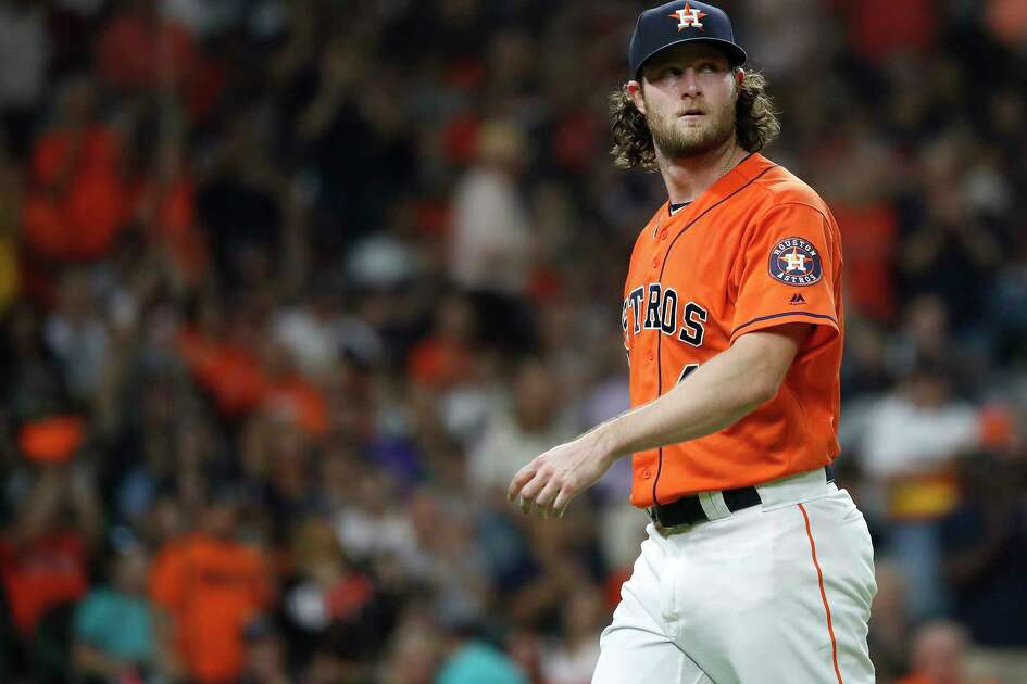 Houston Astros starting pitcher Gerrit Cole (45) reacts after getting out of the seventh inning of an MLB baseball game at Minute Maid Park, Friday, September 21, 2018, in Houston.