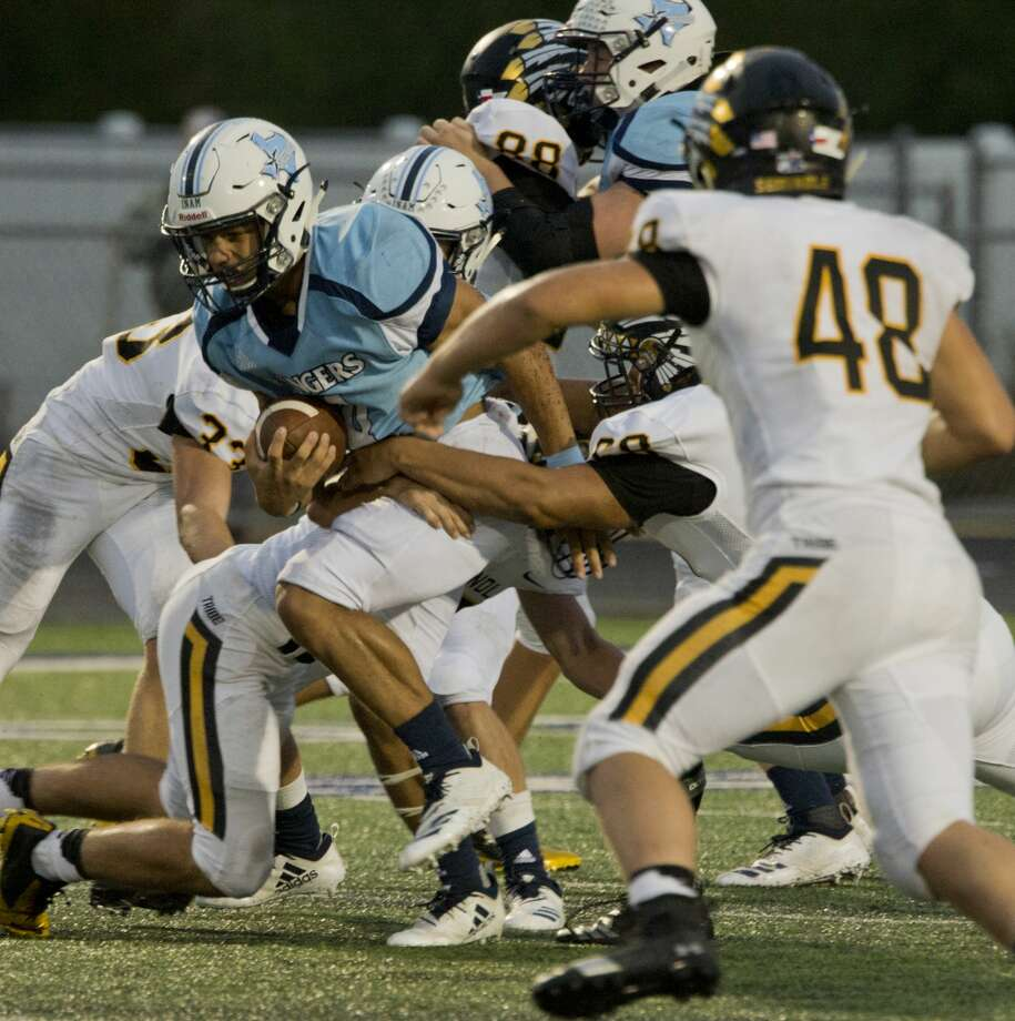 Greenwood's Trey Cross tries to break free as Seminole defenders hold on 09/21/18 at J.M. King Memorial Stadium. Tim Fischer/Reporter-Telegram Photo: Tim Fischer/Midland Reporter-Telegram