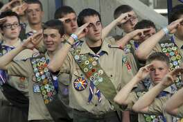 FILE--In this July 3, 2010, file photo, Boy Scouts salute during the Stadium of Fire in Provo, Utah. The Mormon church's new youth program it will roll out in 2020 when it cuts all ties with Boy Scouts of America will still include outdoor and adventure activities even as the initiative becomes more gospel-focused, the faith confirmed Friday, Sept. 21, 2018. (Rick Egan/The Salt Lake Tribune via AP, file)