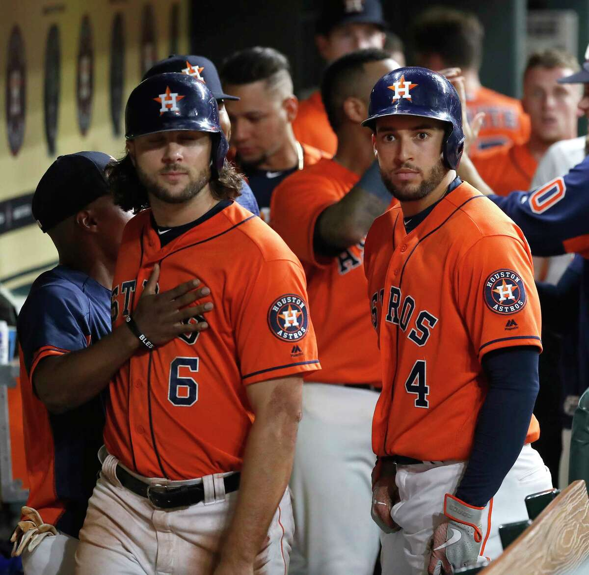 Houston Astros George Springer (4) celebrates his three-run home run with a dugout stare during the eighth inning of an MLB baseball game at Minute Maid Park, Friday, September 21, 2018, in Houston.