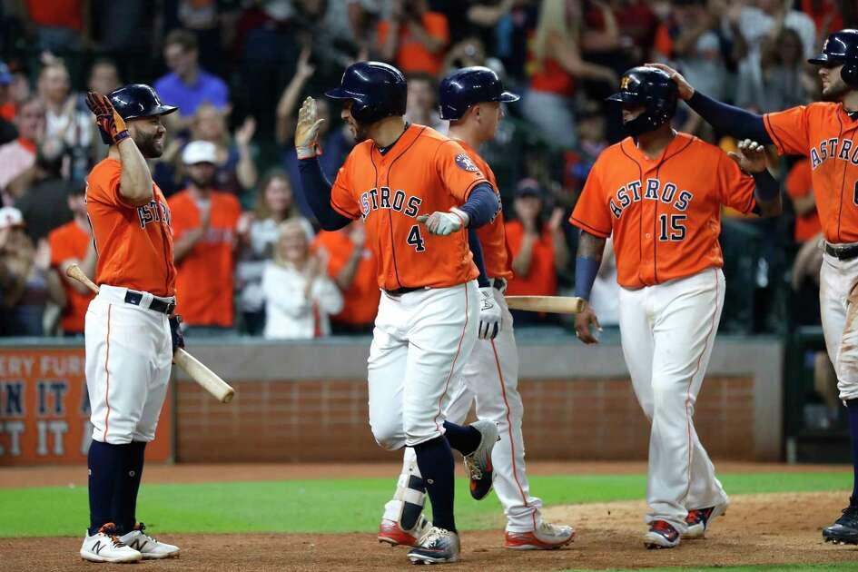 Houston Astros George Springer (4) celebrates his three-run home run during the eighth inning of an MLB baseball game at Minute Maid Park, Friday, September 21, 2018, in Houston.