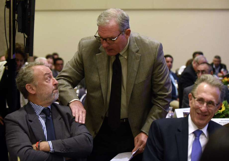 Mayor Dee Margo of El Paso greets former Mexican Ambassador to the U.S. Arturo Sarukhan as former U.S. Ambassador to Mexico Tony Wayne, right, sits by at the Border Mayors Association Summit on Friday, Sept. 21 2018. Photo: Billy Calzada /San Antonio Express-News / San Antonio Express-News