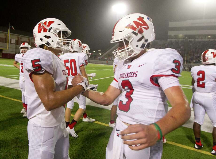 The Woodlands running back Bryeton Gilford (5) celebrates with quarterback Casey Sunseri (3) after Gilford's 16-yard go-ahead touchdwon during the fourth quarter of a District 15-6A high school football game at Woodforest Bank Stadium, Friday, Sept. 21, 2018, in Shenandoah. Photo: Jason Fochtman, Staff Photographer / © 2018 Houston Chronicle