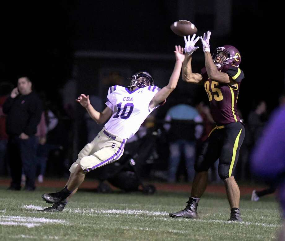 Colonie's Josiah Kemp (85) pulls in a touchdown pass in front of Christian Brothers Academy's Dylan Jones (10) during a Section II Class AA High School football game Friday, Sept. 21, 2018, in Colonie, N.Y. (Hans Pennink / Special to the Times Union) Photo: Hans Pennink / Hans Pennink
