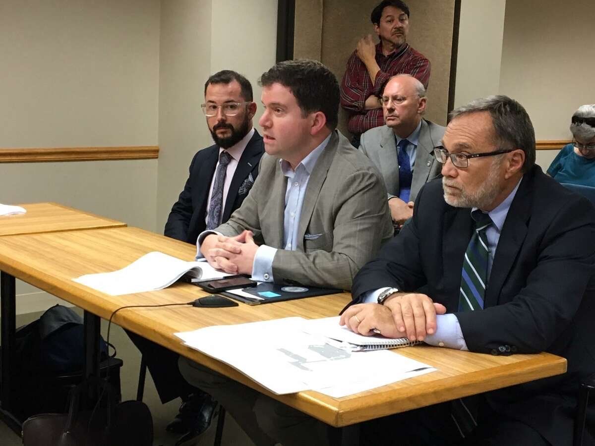 From left, Josh Blevins of Reed Realty Group, architect Jeremiah Russell and attorney David Hoopes speak at a City Plan Commission meeting in New Haven.