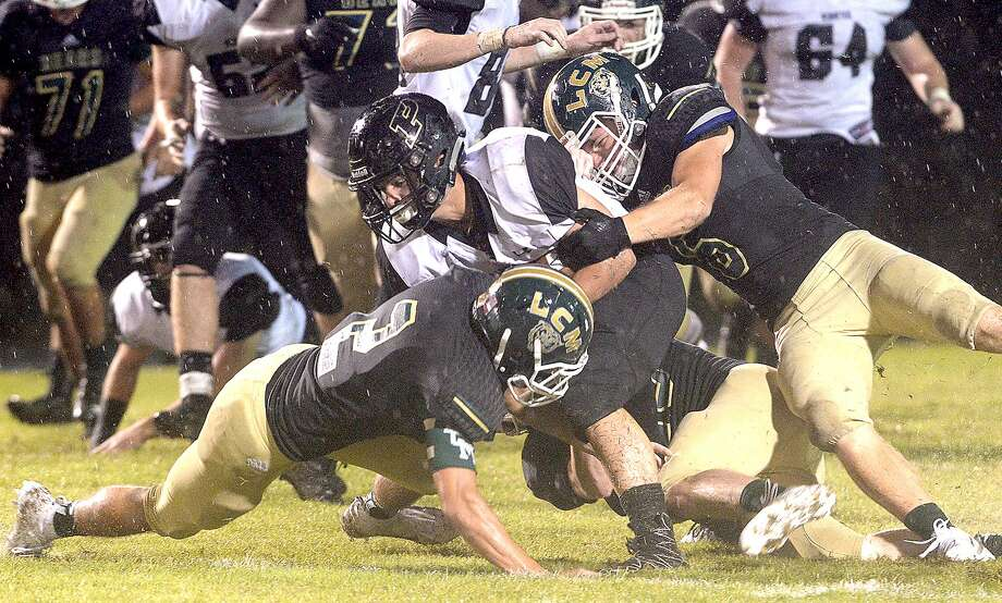 Vidor's Brad Nunez is stopped by Little Cypress-Mauriceville's defense, including Justin Lee (bottom), during their match-up Friday night at LC-M.  Friday, September 21, 2018  Kim Brent/The Enterprise Photo: Kim Brent / The Enterprise / BEN
