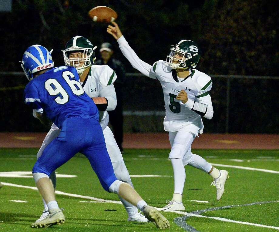 Shenendehowa QB #5 Brendan Belot fires off a pass as #66 Dylan Blowers blocks Shakers' 96 Xavier Mein, left,  during Friday night's game Sept. 21, 2018 in Colonie, NY.  (John Carl D'Annibale/Times Union) Photo: John Carl D'Annibale / 20044879A