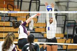 Cigarroa High School Joslin Rodriguez plays the net during a game against Tuloso-Midway High School on Friday, Sept. 21, 2018 at Cigarroa High School.