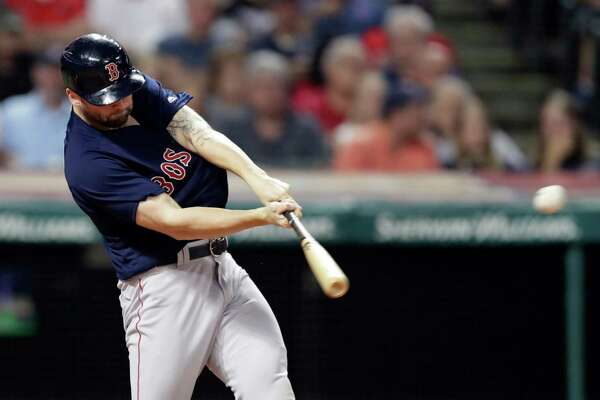 Boston Red Sox's Sam Travis hits a two-run double in the seventh inning of a baseball game against the Cleveland Indians, Friday, Sept. 21, 2018, in Cleveland. (AP Photo/Tony Dejak)