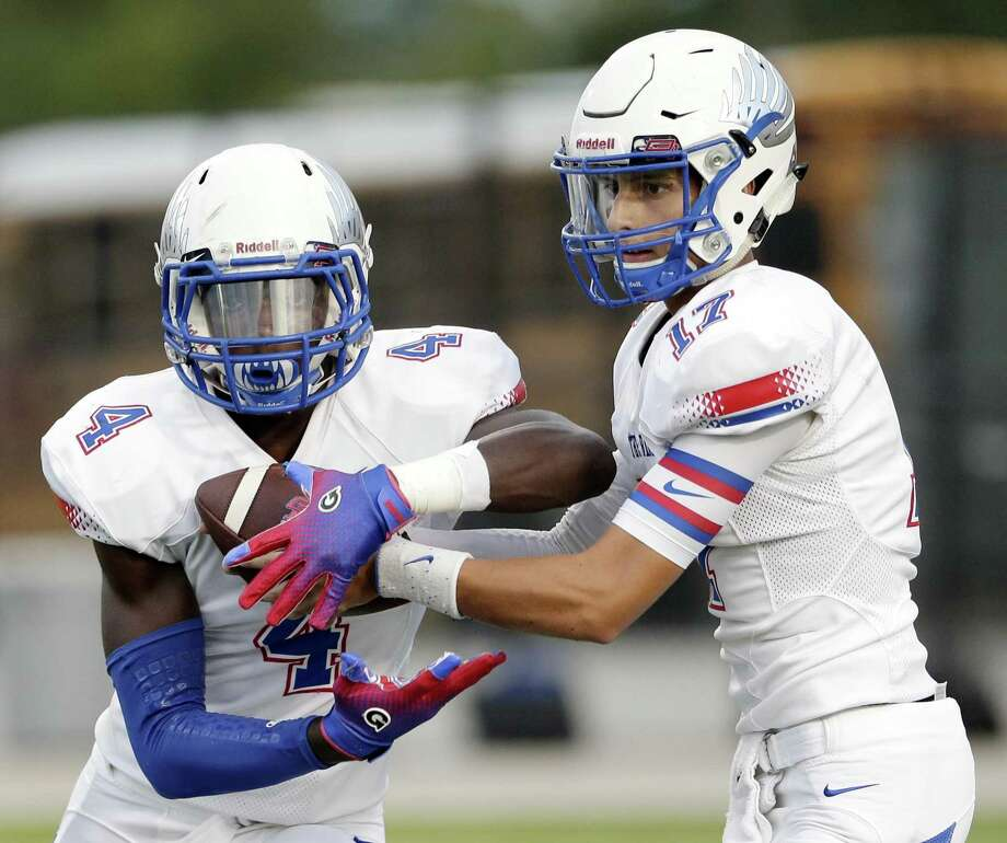 Oak Ridge's Alton McCaskill (4) takes the hand off from Blane Romero (17) during the first half of their game against The Woodlands back in September. Photo: Michael Wyke, Houston Chronicle / Contributor / © 2018 Houston Chronicle