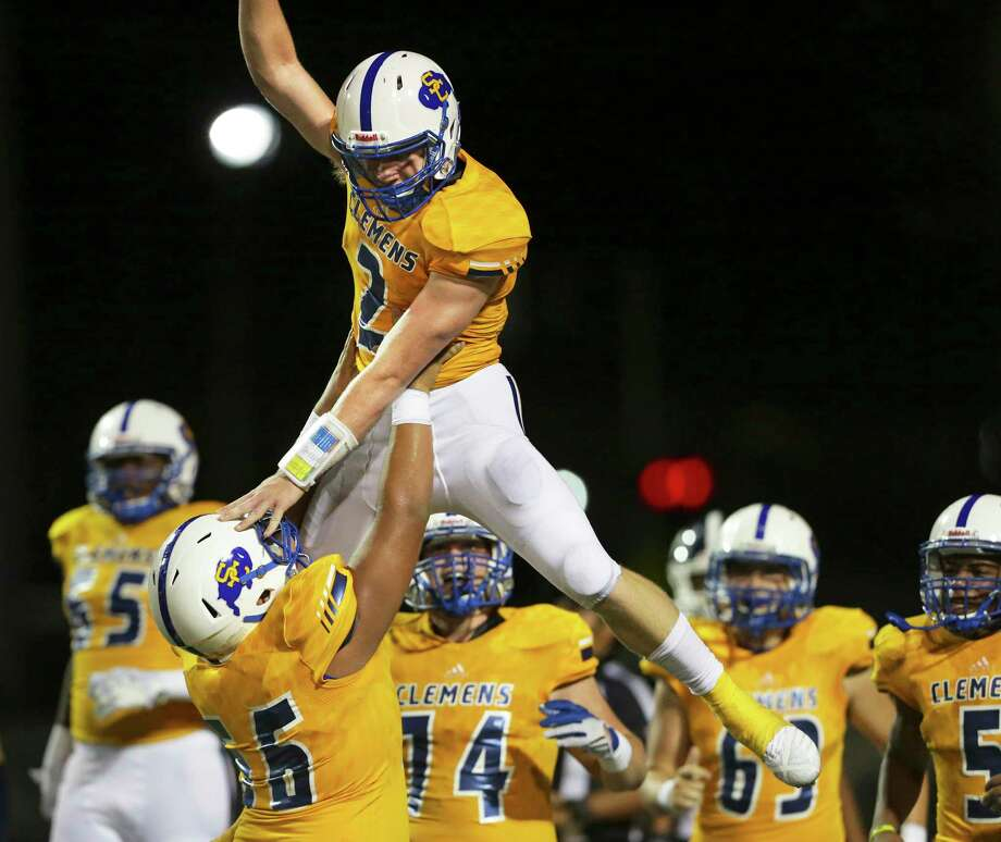 Buffalo quarterback Max Didomenico is hoisted by teammates after a long touchdown sprint in the first half as Clemens hosts Smithson Valley at Lehnhoff Stadium on September 21, 2018. Photo: Tom Reel, Staff / Staff Photographer / 2017 SAN ANTONIO EXPRESS-NEWS
