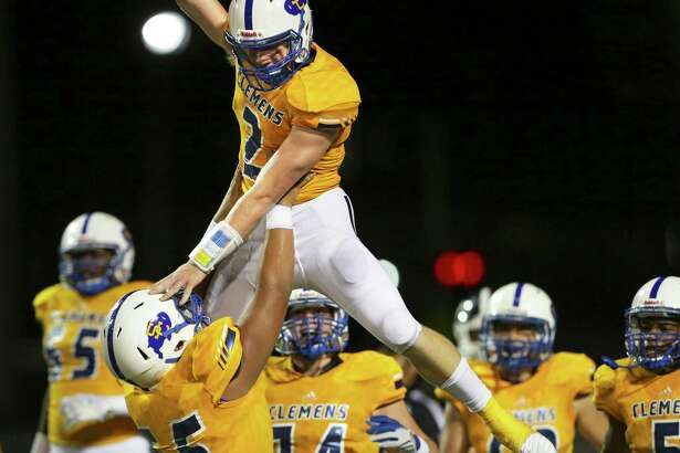 Buffalo quarterback Max Didomenico is hoisted by teammates after a long touchdown sprint in the first half as Clemens hosts Smithson Valley at Lehnhoff Stadium on September 21, 2018.