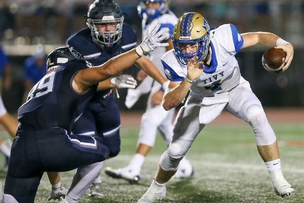 Kerrville Tivy's Cole Miears (right) tries to run past Boerne Champion's Rocco King (left) and Walker Scott during the first half of their high school football district 14-5A-II game at Boerne Stadium on Friday, Sept. 21, 2018.