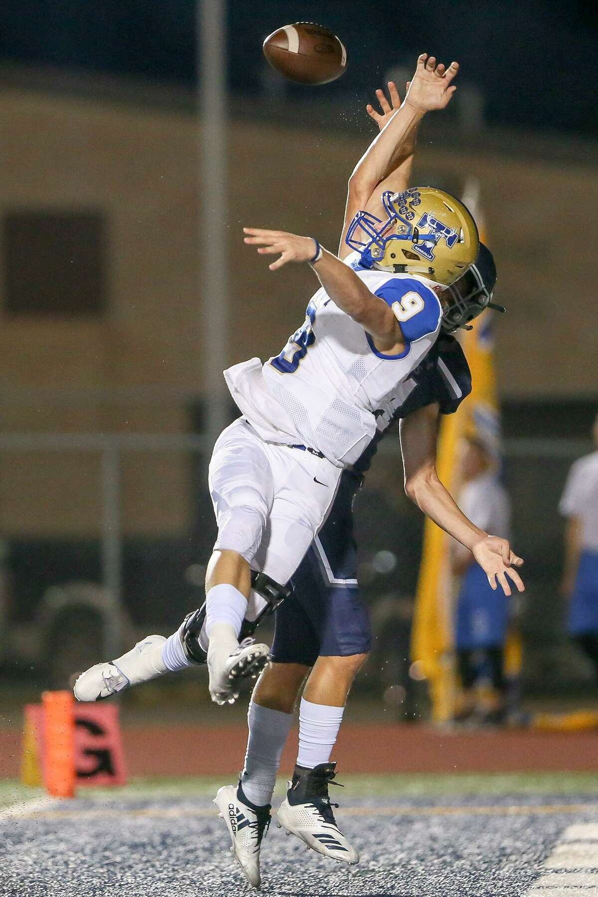 Kerrville Tivy's Trapper Pannell (left) and Boerne Champion's Kyle Bowman fight for the ball in the enz zone during the first half of their high school football district 14-5A-II game at Boerne Stadium on Friday, Sept. 21, 2018.