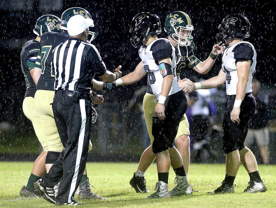 Vidor and Little Cypress-Mauriceville's captains meet center field before game start during their match-up Friday night at LC-M. Friday, September 21, 2018 Kim Brent/The Enterprise Photo: Kim Brent/The Enterprise