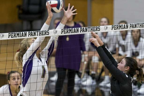 Chloe Rivera (2) tips past a Midland High player. Permian played Midland High Friday night at the Permian Field House. 9/21/2018 Jacy Lewis/191 News