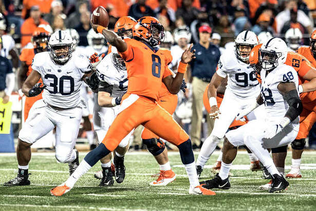 Illinois quarterback MJ Rivers (8) passes during Saturday night's game against Penn State at Memorial Stadium in Champaign.