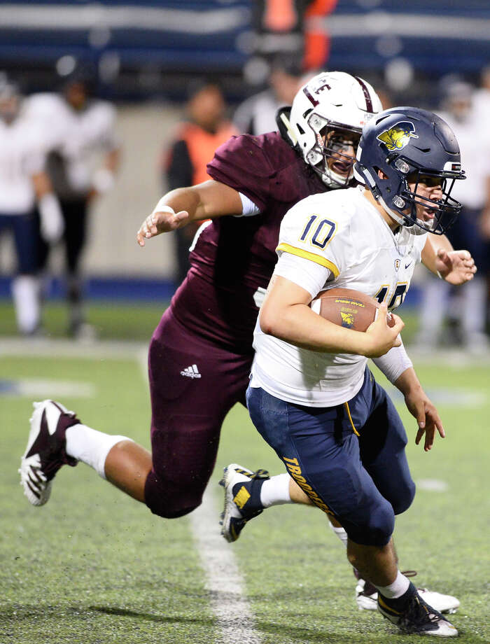 Lee's Charlie Gonzales (36) closes in on El Paso Eastwood quarterback Christian Castaneda (10) on Sept. 21, 2018, at Grande Communications Stadium. James Durbin/Reporter-Telegram Photo: James Durbin / ? 2018 Midland Reporter-Telegram. All Rights Reserved.