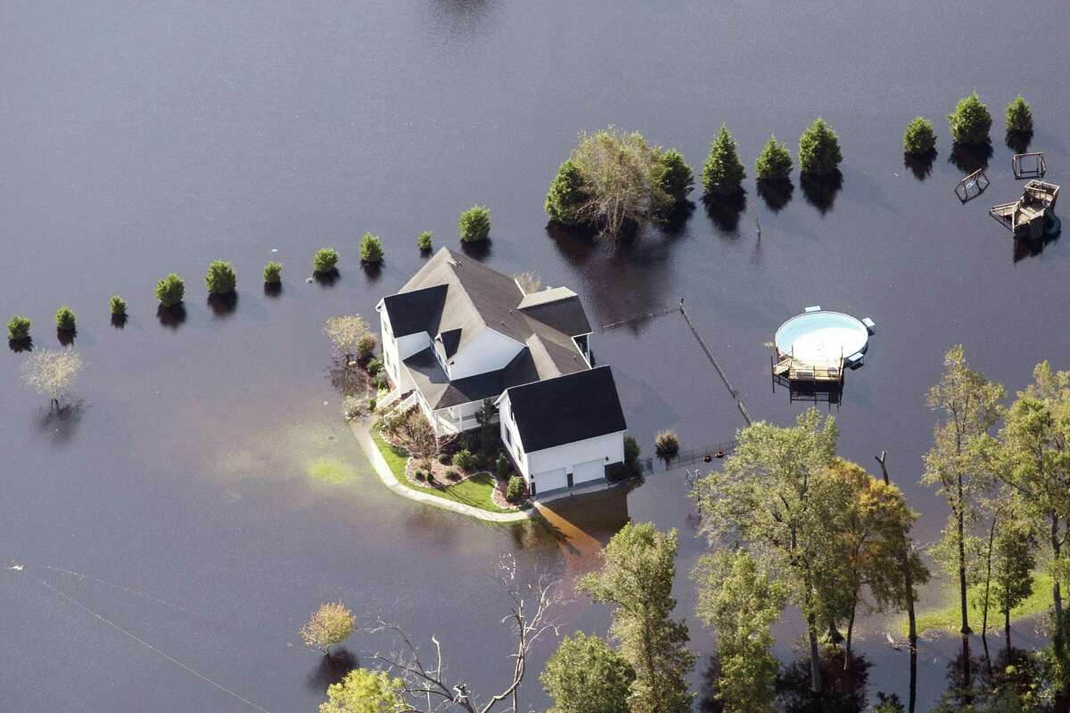 A home surrounded by floodwater is seen in this aerial photograph taken above Kinston, North Carolina, on Friday, Sept. 21, 2018. Record floods cover much of eastern North Carolina in the wake of Hurricane Florence, and the waters are still rising.