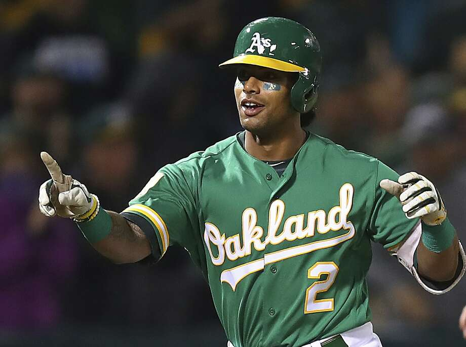 Oakland Athletics' Khris Davis celebrates after hitting a walk-off home run in the 10th inning of a baseball game against the Minnesota Twins on Friday, Sept. 21, 2018, in Oakland, Calif. (AP Photo/Ben Margot) Photo: Ben Margot / Associated Press