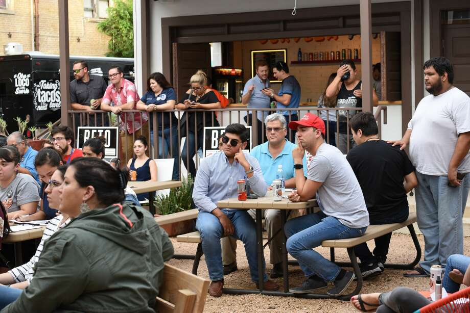 People gather at Cultura Beer Garden as it hosts a Beto O'Rourke/Ted Cruz debate watch party, Friday, September 21, 2018. Photo: Christian Alejandro Ocampo/Laredo Morning Times
