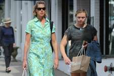 Women carry their shopping items in paper bags down Greenwich Avenue in Greenwich, Conn. Wednesday, Sept. 19, 2018. Stores and customers have had mixed reactions since the plastic bag ban was implemented in Greenwich on Wednesday Sept. 12.