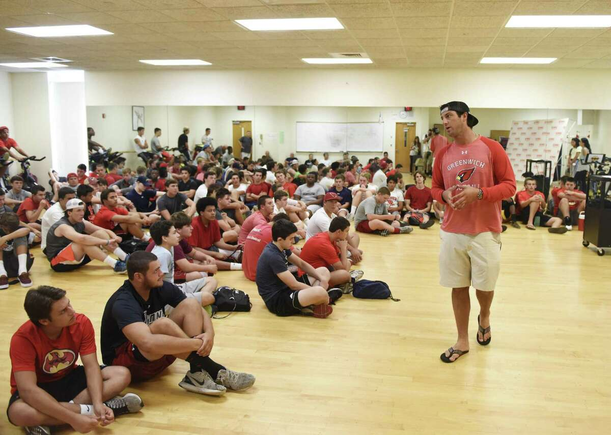 Greenwich High School football coach John Marinelli speaks about teen dating violence with the players at GHS in 2016.