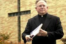 The Rev. Robert Morrissey is shown in a file photo from September 2001, at St. Mary's Church in Ridgefield, Conn. Morrissey is one of three former priests from the Roman Catholic Diocese of Bridgeport named in a lawsuit filed by five men claiming that they were sexually abused as children.
