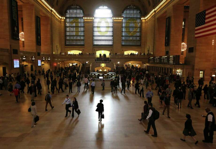 FILE- In this Sept. 26, 2013, file photo people make their way through Grand Central Terminal in New York. Travel can be busy, noisy and crowded — a potentially daunting environment for anyone. But if you're an introvert, it can drain your internal battery. Studies and experts suggest this personality type processes social stimuli differently from extroverts, who don't mind frequent interaction. (AP Photo/Mary Altaffer, File) Photo: Mary Altaffer / Copyright 2018 The Associated Press. All rights reserved.
