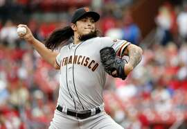 San Francisco Giants starting pitcher Dereck Rodriguez throws during the first inning of a baseball game against the St. Louis Cardinals, Saturday, Sept. 22, 2018, in St. Louis. (AP Photo/Jeff Roberson)