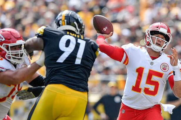 Kansas City Chiefs quarterback Patrick Mahomes (15) throws one of six touchdown passes against the Pittsburgh Steelers and defensive end Stephon Tuitt (91) on September 16, 2018, at Heinz Field in Pittsburgh. (John Sleezer/Kansas City Star/TNS)