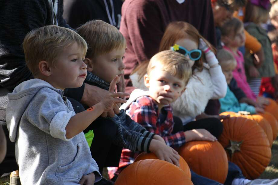 Hot cider, warm donuts, pumpkins, pumpkins and more pumpkins were a few ingredients needed for Caseville's annual PumpkinFest. Saturday's events included the pumpkin roll, scarecrow-making and sidewalk decorating. Photo: Bradley Massman/Huron Daily Tribune