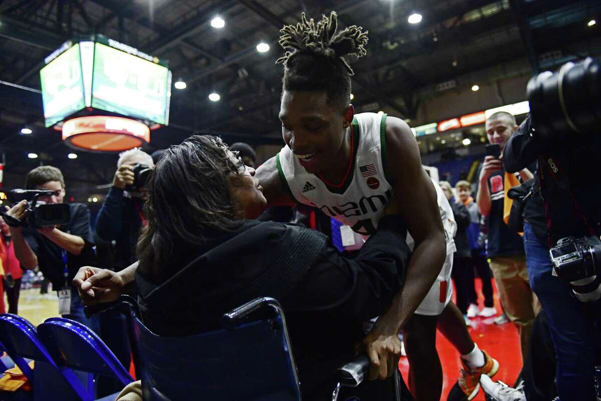 READING, PA - NOVEMBER 22: Lonnie Walker IV #4 of the Miami (Fl) Hurricanes hugs his grandmother, Eleanore Carter, after the game at Santander Arena on November 22, 2017 in Reading, Pennsylvania. According to reports, Walker committed to Miami on the conditions a game be played in his hometown --†for Walker's grandmother to see. Miami defeated La Salle 57-46. (Photo by Corey Perrine/Getty Images)