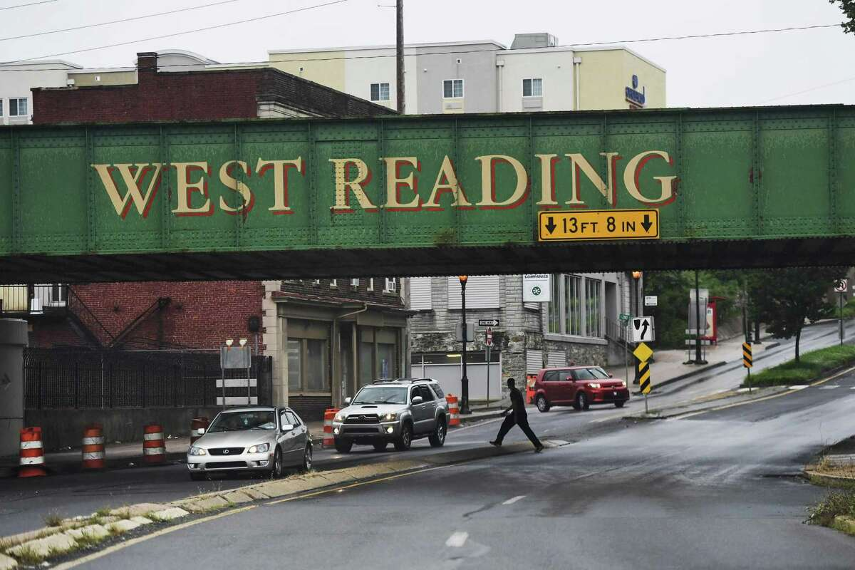 A man walks under the West Reading Railroad tracks Monday, Sept. 17, 2018 in Reading, Pa. Lonnie Walker IV, 19, is a former Reading High School PIAA 6A state basketball champion, University of Miami freshman standout and now a first-round draft pick for the San Antonio Spurs. Humble in his accomplishments, on and off the court, Walker IV claims he's