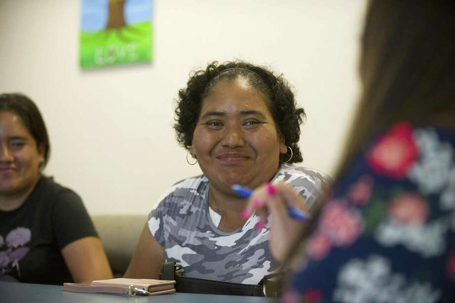 Salome Zuniga, mother of a seventh grader in the Trailblazers program, meets with family advocate Cecilia Tumbaco inside the nonprofit Domus on Lockwood Avenue on Thursday. Photo: Michael Cummo / Hearst Connecticut Media / Stamford Advocate