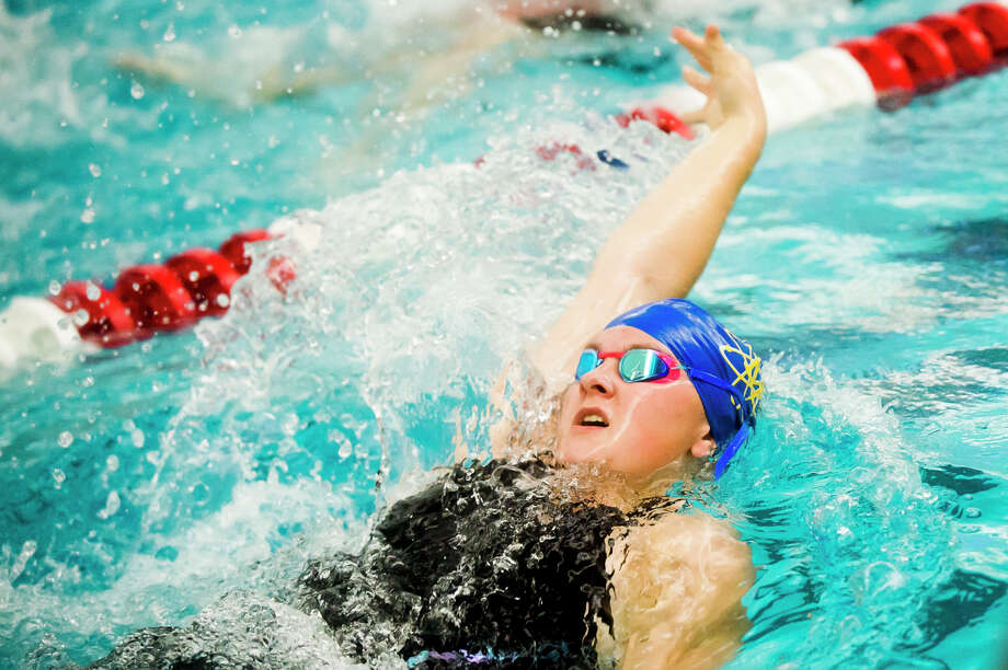 Midland senior Katie Berchert competes in the 100 yard backstroke during the Tri-City Championship Swimming & Diving Finals on Saturday, Sept. 22, 2018 at Saginaw Valley State University. (Katy Kildee/kkildee@mdn.net) Photo: (Katy Kildee/kkildee@mdn.net)