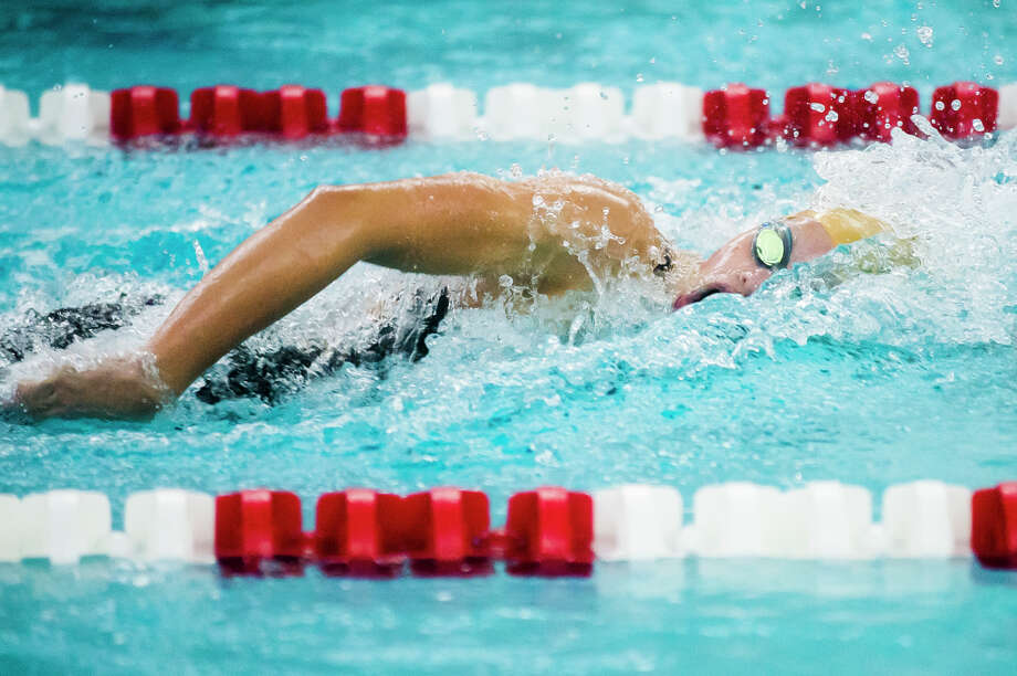 Dow junior Claire Newman competes in the 100 yard freestyle during the Tri-City Championship Swimming & Diving Finals on Saturday, Sept. 22, 2018 at Saginaw Valley State University. (Katy Kildee/kkildee@mdn.net) Photo: (Katy Kildee/kkildee@mdn.net)