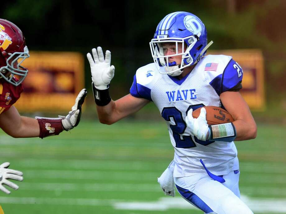 Darien's Tyler Herget carries the ball during the Blue Wave's 22-7 victory over St Joseph on Saturday in Trumbull. Photo: Christian Abraham / Hearst Connecticut Media / Connecticut Post