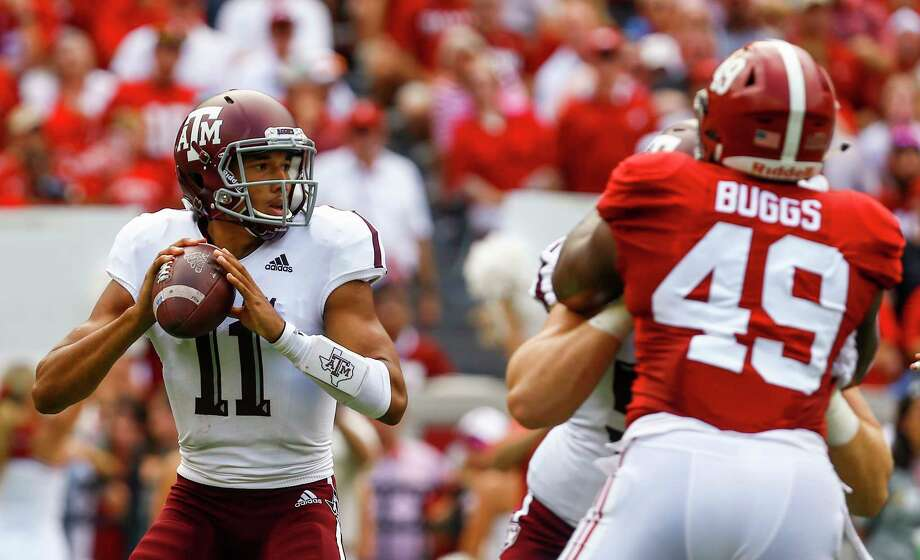 Texas A&M quarterback Kellen Mond (11) drops back to pass during the first half of an NCAA college football game against Alabama, Saturday, Sept. 22, 2018, in Tuscaloosa, Ala. (AP Photo/Butch Dill)  Photo: Butch Dill, Associated Press / Copyright 2018 The Associated Press. All rights reserved.