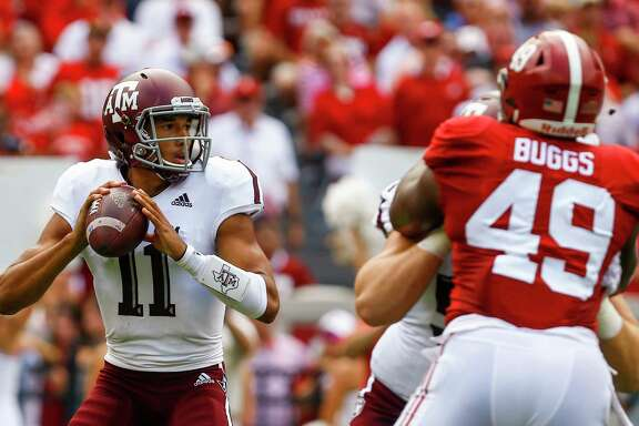Texas A&M quarterback Kellen Mond (11) drops back to pass during the first half of an NCAA college football game against Alabama, Saturday, Sept. 22, 2018, in Tuscaloosa, Ala. (AP Photo/Butch Dill)