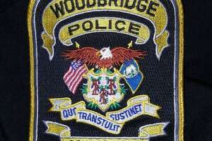 FILE PHOTO — Woodbridge police patch.